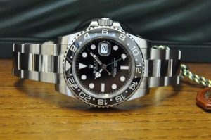 The stainless steel copy Rolex GMT-Master II 116710LN watches have black dials.